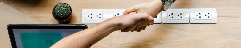 shaking hands over outlet